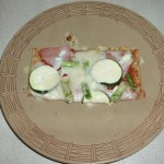 Pizza with asparagus, zucchini and ham on a whole wheat crust